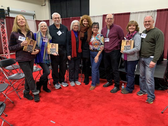 "Contest winners of Homestyle's Coffee and Tea with ""Trading Spaces"" designer Laurie Smith, fifth from the left, met with her Saturday morning at the Novi Home Show."