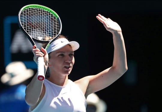 Romania's Simona Halep celebrates after defeating Kazakhstan's Yulia Putintseva in their third-round singles match Saturday at the Australian Open.