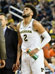 Michigan forward Isaiah Livers reacts after a painful play in the second half.