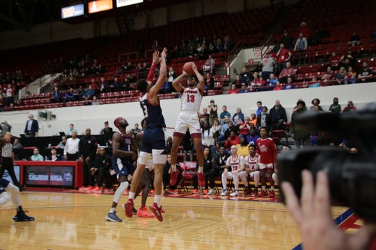 Alonde LeGrand hits the winning shot for Detroit Mercy on Saturday.