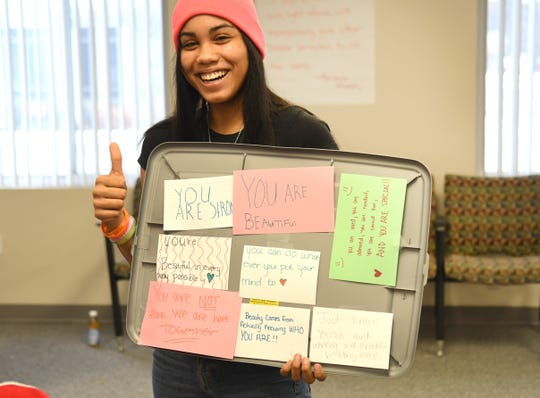 Alexis Davis displays messages created by participants of the Who Am I Conference in Southfield on Saturday, January 25, 2020.