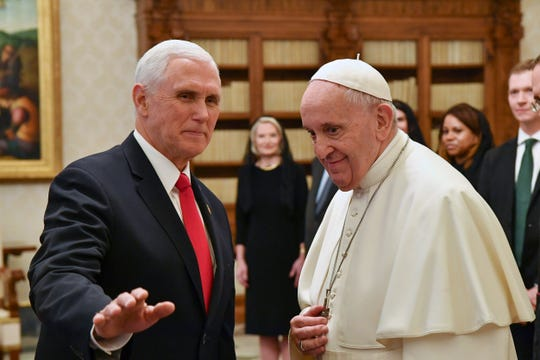 Pope Francis meets with US Vice President Mike Pence, left, on the occasion of their private audience, at the Vatican, Friday, Jan. 24, 2020.