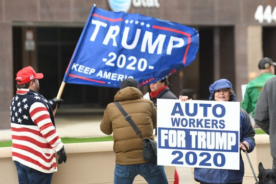 Ben Hirschmann, left, of Fraser and Deborah Fuqua-Frey of Willis rally outside the McNamara Federal Building in Detroit on Saturday, Jan. 25, 2020.