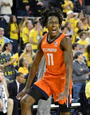 Illinois guard Ayo Dosunmu (11) reacts after hitting the go-ahead basket in the second half.