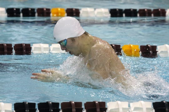 Corning's Cal Bartone swims to first place in the 100-yard breaststroke at the John Beecher Boys Swimming and Diving Invitational at Ernie Davis Academy in Elmira on Jan. 25, 2020.