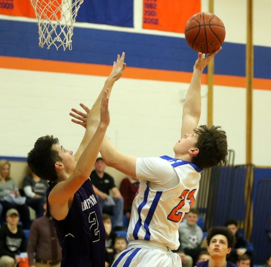 Tyler Korsky of Thomas A. Edison puts up a shot as Dryden's Ethan Hicks defends during the Spartans' 60-42 win in boys basketball Jan. 24, 2020 in Elmira Heights.