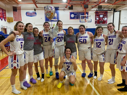 Owego Free Academy's Kaci Donovan (20) celebrates with teammates after becoming the school's career scoring leader Jan. 24, 2020 in a 74-30 home win over Binghamton. Donovan scored 17 points to raise her career total to 1,727, passing the previous record held by Kyle Dougherty.