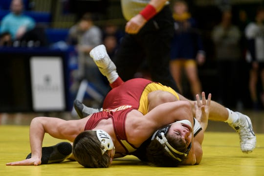Mater Dei's Brody Baumann pins Central's Luke Kemper during the 145-pound weight class championship of the 64th annual Southern Indiana Athletic Conference wrestling tournament at Castle High School in Newburgh, Ind., Saturday, Jan. 25, 2020. Baumann won the match to become the 145-pound champion.