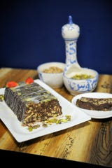 Lazy Cake is made with a cooked chocolate fudge stirred with broken graham crackers or tea biscuits and refrigerated. Hadeel Alaqtash tops hers with pistachios and a drizzle of vanilla glaze at Kabob Xpress.