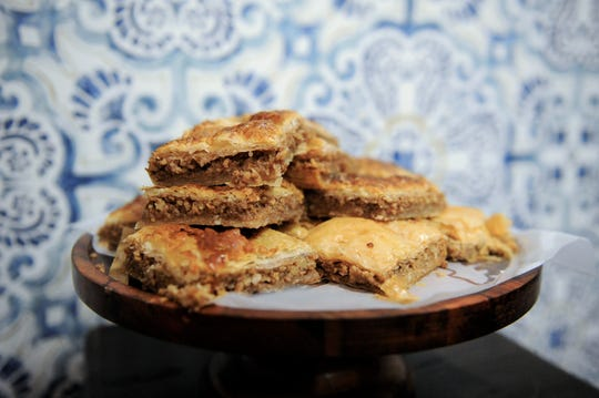 Baklava with a walnut and sugar filling between layers of buttery phyllo pastry at Kabob Xpress.
