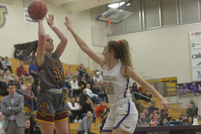 Rocky Mountain basketball player Lily Smith shoots while Fort Collins' Olivia Deines defends during a game against Fort Collins on Friday, Jan. 24, 2020. Fort Collins won 50-46.