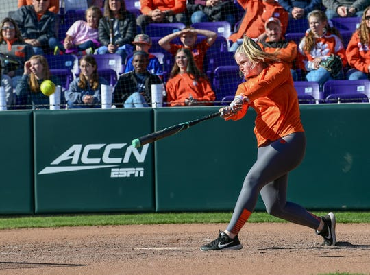 Clemson softball player M.K. Bonamy demonstrates her hitting for a crowd during Clemson softball fan day at the stadium Saturday, January 25, 2020.