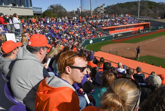 Clemson softball fan Sam Gilmer of Honea Path watches with fans as the team demonstrates skills during Clemson softball fan day at the stadium Saturday, January 25, 2020.