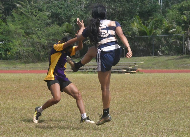 Action from opening day in the Guam Department of Education's Interscholastic Athletic Association High school Rugby season held Jan. 25 at Okkodo High School.