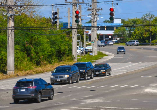 A motorist, in lower left, runs through a red light signal at the intersection of Vietnam Veteran Highway (Route 10) and University Drive in Mangilao on Saturday, Jan. 25, 2020.