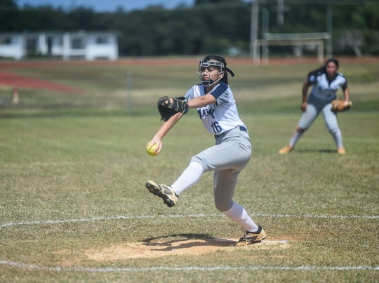 In this file photo from Jan. 25, 2020, Academy's Isabella Dangan pitches against the Simon Sanchez Sharks during their ISA Girls Softball League game at George Washington High School in Mangilao.