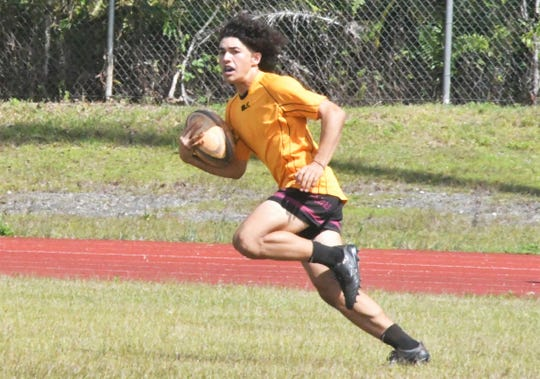The Father Duenas Memorial School Friars, with a player shown here in this Jan. 25 file photo, improved to 6-0 in the Guam Rugby Football Union/Interscholastic Sports Association High School Rugby League with a 40-7 blowout win over the Okkodo High Bulldogs.