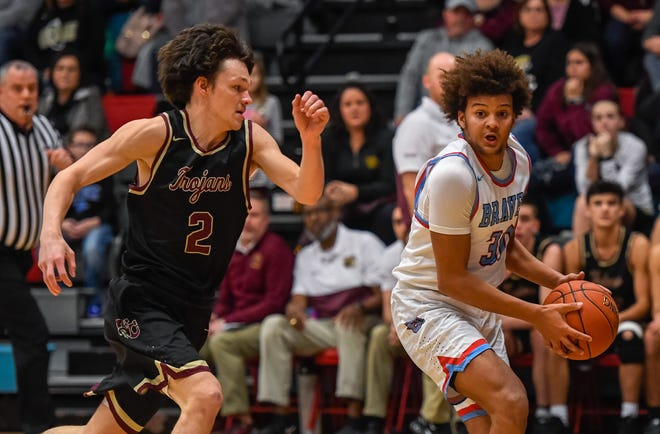 Union County's Izaiah Manuel (30) drives to the basket under pressure from Webster County's Tyler Camplin (2) as the Webster Trojans plays the Union County Braves at Union's Doug Hines gym Friday evening, January 24, 2020.