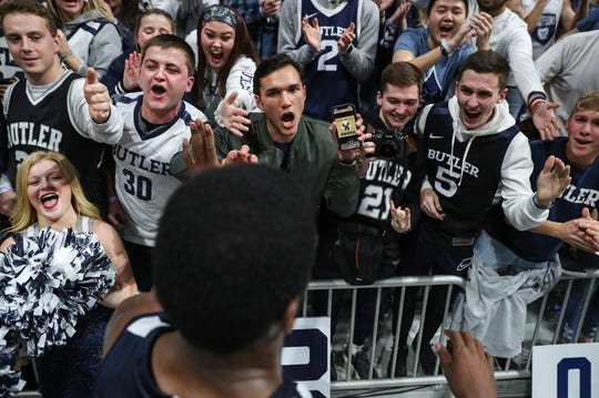 Butler students celebrate with Kamar Baldwin (3) as he leaves the court after the team defeated Marquette in overtime, 89-85, at Hinkle Fieldhouse in Indianapolis on Friday, Jan. 24, 2020.