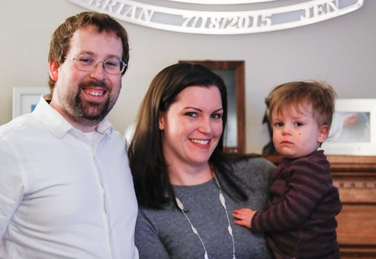 Jen and Brian Walker hold their son Michael at their Indiana home, Thursday, Jan. 25, 2020. After Michael's birth, the couple was hit with a substantial medical bill and months of wrangling with their insurance company.