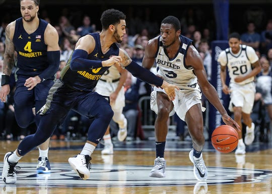 Marquette Golden Eagles guard Markus Howard (0) is unable to strip the ball from Butler Bulldogs guard Kamar Baldwin (3).
