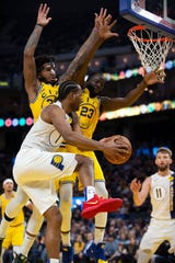 Jan 24, 2020; San Francisco, California, USA; Indiana Pacers forward T.J. Warren (1) passes the ball around Golden State Warriors center Marquese Chriss (32) and forward Draymond Green (23) during the fourth quarter at Chase Center. Mandatory Credit: D. Ross Cameron-USA TODAY Sports
