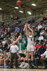 Brownsburg's Connor Lucas (3) with the 3-point attempt during the Brownsburg vs Westfield varsity IHSAA boys basketball game held at Brownsburg High School, January 24, 2020.
