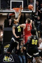 Purdue guard Nojel Eastern (20) blocks Wisconsin forward Micah Potter (11)'s layup during the first half of a NCAA men's basketball game, Friday, Jan. 24, 2020 at Mackey Arena in West Lafayette.