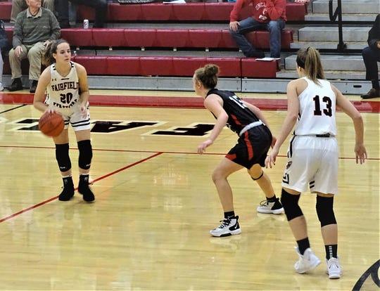 Fairfield Union sophomore guard Hannah Rauch dribbles against a Logan Elm defender while teammate Evie Wolshire gets ready to set a pick. The Falcons fell short, 56-49.