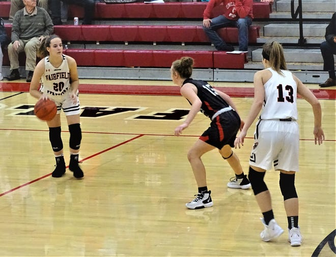 Fairfield Union sophomore guard Hannah Rauch dribbles against a Logan Elm defender while teammate Evie Wolshire gets ready to set a pick. The Falcons fell short, 56-49.