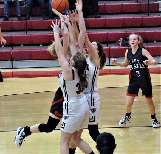 Fairfield Union's Claire Cooperider and Evie Wolshire defends against a Logan Elm shooter during Friday's 56-49 loss to the Braves.