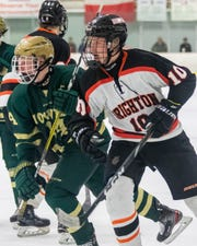 Brighton's Will Jentz and (10) Howell's Stefan Frantti pursue the puck on Friday, Jan. 24, 2020.