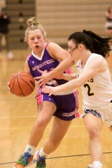 Brighton's Isabella Vogt drives to the basket while guarded by Hartland's Syd Caddell on Friday, Jan. 24, 2020.