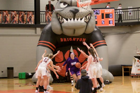 Led by senior Sophie Dziekan, Brighton's girls basketball players take the court against Hartland on Friday, Jan. 24, 2020.
