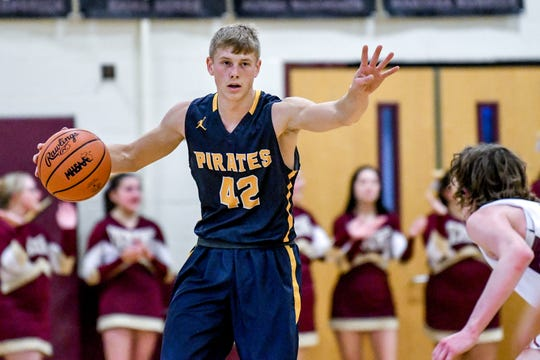 Pewamo-Westphalia's Nathen Martin calls a play during the first quarter on Friday, Jan. 24, 2020, at Potterville High School.