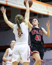 SPASH's Leah Earnest (40) puts up a shot against Marshfield on Jan. 24.