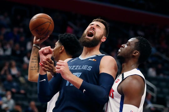 Memphis Grizzlies center Jonas Valanciunas (17) reacts after being fouled by Detroit Pistons forward Christian Wood, left, during the first half.