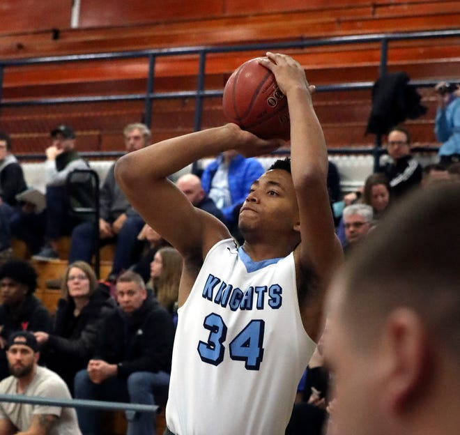 Nicolet forward James Graham puts up a three-pointer against Whitefish Bay.