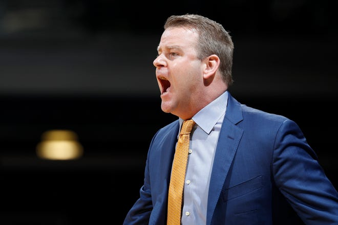 Marquette head coach Steve Wojciechowski shouts instructions to his team as it takes on Butler.