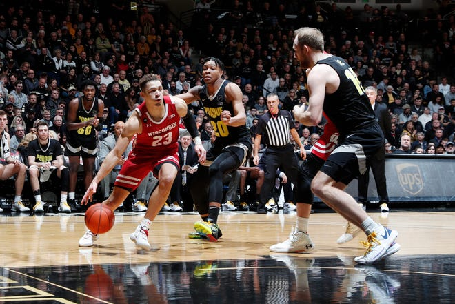 Wisconsin guard Kobe King drives past Purdue guard Nojel Eastern during the first half.