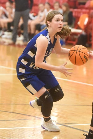 Cotter's Afton Massey drives to the basket during a recent game at Flippin. The Lady Warriors defeated Flippin 47-42 on Friday night at Cotter.