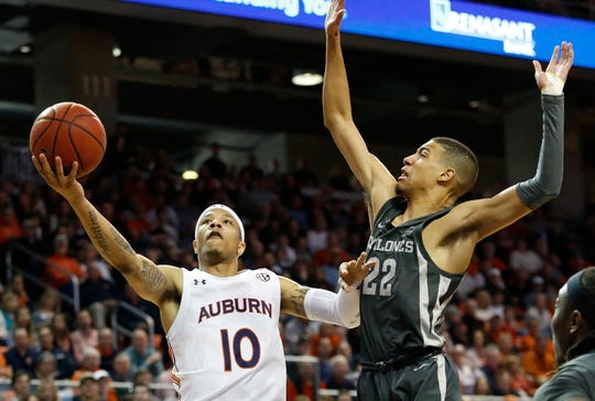 Auburn guard Samir Doughty (10) gets past Iowa State Cyclones guard Tyrese Haliburton (22) on Jan. 25, 2020.
