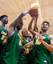 Carver players take their westside trophy after defeating Lanier on the Lanier campus in Montgomery, Ala., on Friday January 24, 2020.
