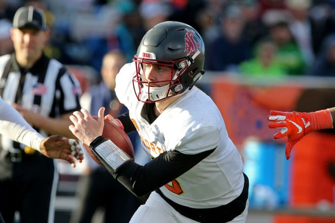 North quarterback Anthony Gordon of Washington State (3) is pressured looks to pas in the second half of the Senior Bowl on Jan. 25, 2020, at Ladd-Peebles Stadium.