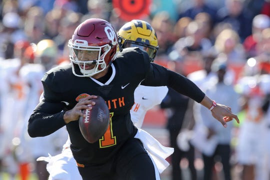 South quarterback Jalen Hurts of Oklahoma (1) runs from pressure by a North defender in the first half of the Senior Bowl on Jan. 25, 2020, at Ladd-Peebles Stadium.