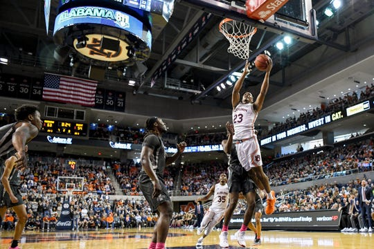 Auburn forward Isaac Okoro (23) scores against Iowa State on Saturday, Jan. 25, 2020, in Auburn, Ala.