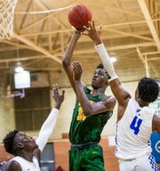 Carver's RayQuan Taylor (33) shoots against Lanier on the Lanier campus in Montgomery, Ala., on Friday January 24, 2020.
