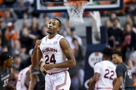 Auburn forward Anfernee McLemore (24) celebrates a 3-point basket against Iowa State on Saturday, Jan. 25, 2020, in Auburn, Ala.