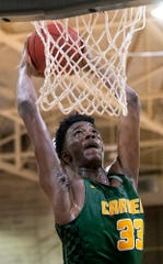Carver's RayQuan Taylor (33) dunks against Lanier on the Lanier campus in Montgomery, Ala., on Friday January 24, 2020.