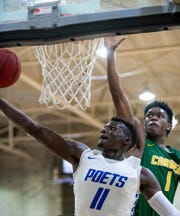 Lanier's Antwan Burnett (11) goes to the hoop against Carver's Ali McMillan (1) on the Lanier campus in Montgomery, Ala., on Friday January 24, 2020.